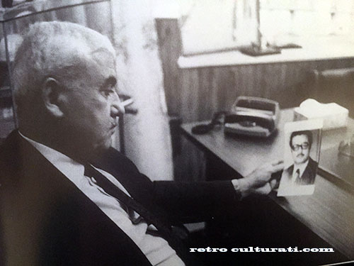 PFLP leader, George Habash looking disdainfully at a photograph of Carlos
